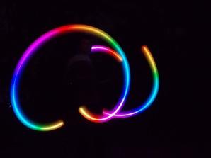 Tristan's rainbow poi photograph by Charlie