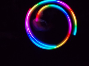 Tristan's rainbow poi photograph by Charlie