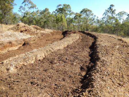 lower trench partially filled with woodchip