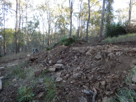 Terraced road, rocky material from holes