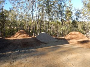 Woodchip and rock piles
