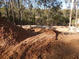 Woodchip shaped to direct water into holes
