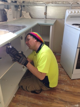 Tristan dismantling the kitchen at the Function Learning Centre Caretakers Cottage