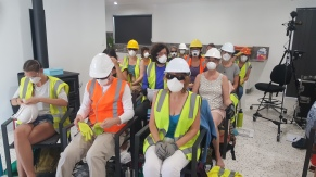 Participants don their PPE (Personal Protective Equipment)during the safety review