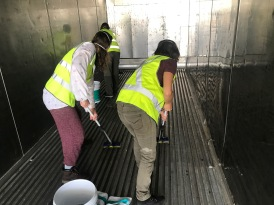 mopping the floor of the container