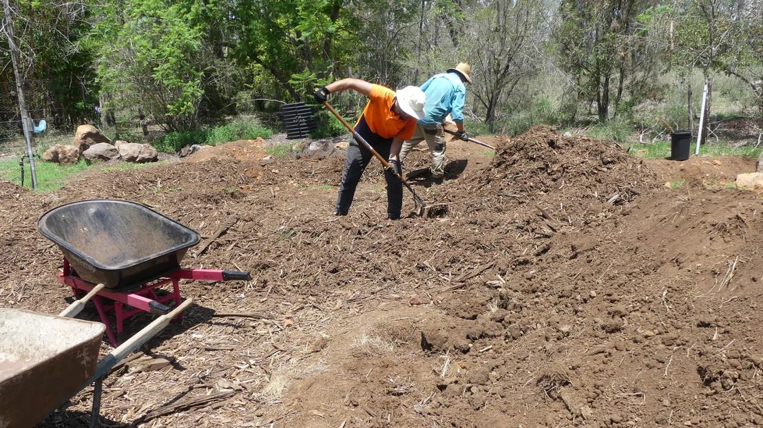 Garden design experiment, volunteers spread mulch, February 2020.