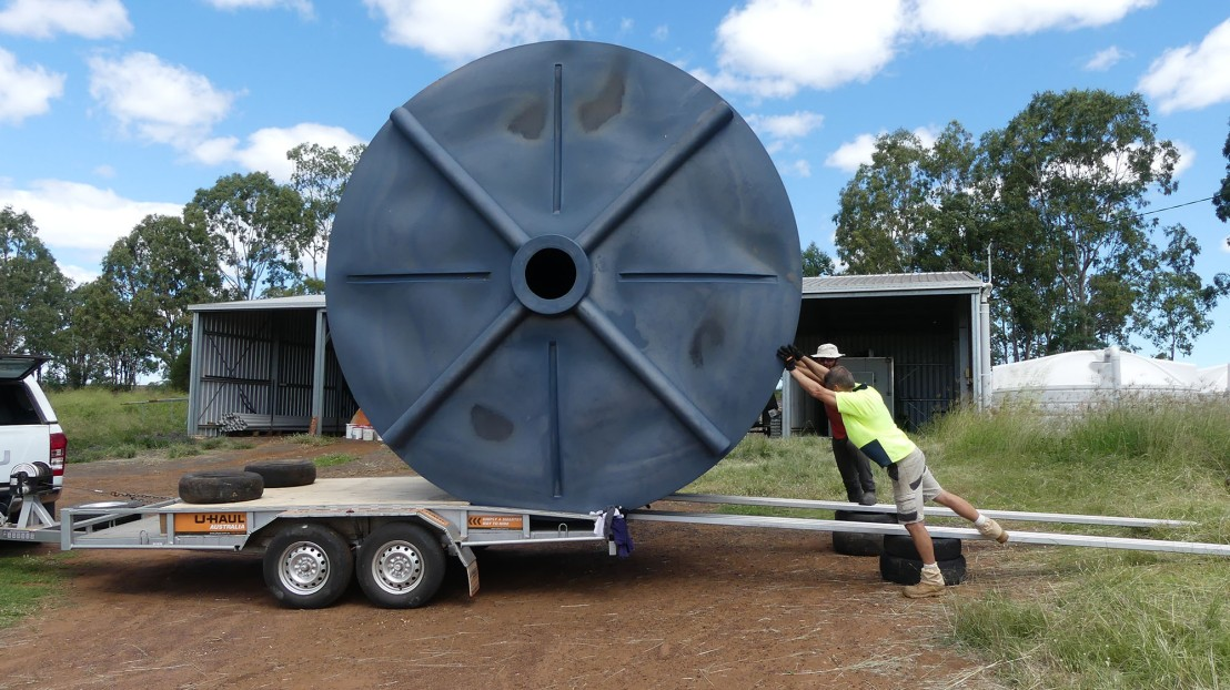 Water tanks are moved onto a trailer
