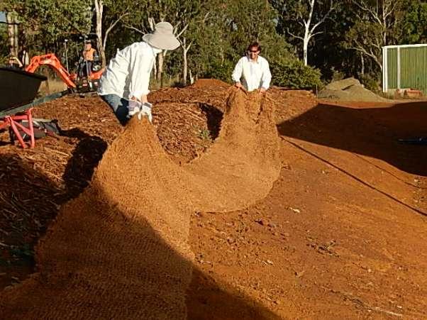 Jesus & Mary spread coconut fibre matting across the bank