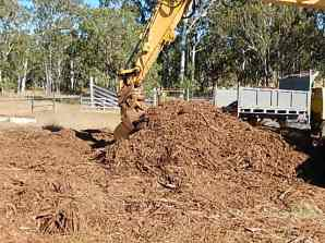 Loading the tip truck with woodchip