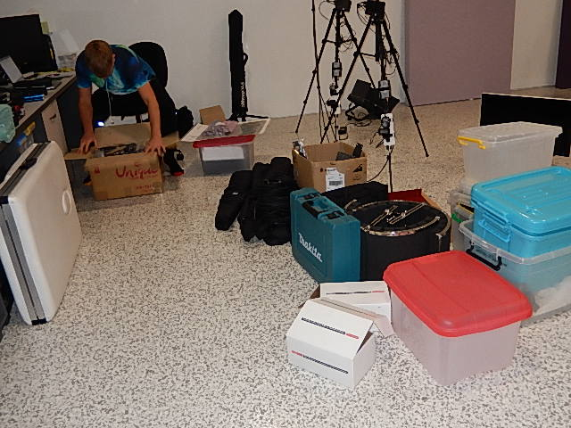 Tristan checks the contents of boxes before returning them to storage in the studio