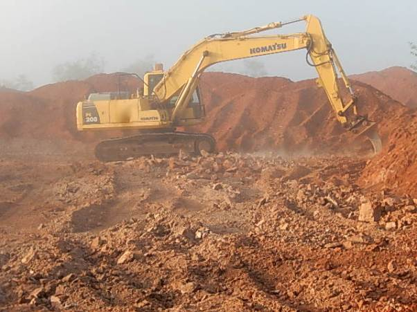 The excavator is using the ripper to break up rock that is too hard for the tines on the dozer. Dust from the work becomes thicker and thicker as the day goes on. In the end you hardly see but it as you become so use to it
