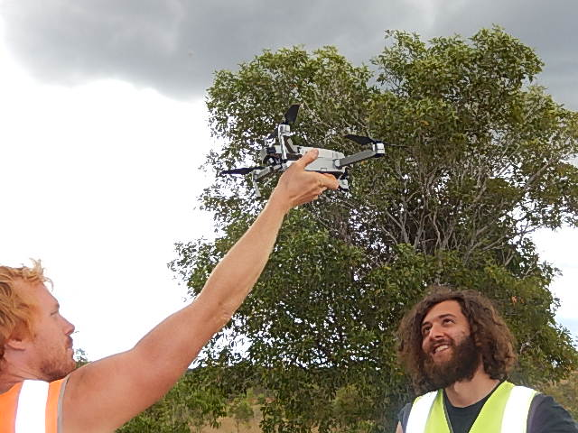 Launching the drone to capture footage of the terracing site
