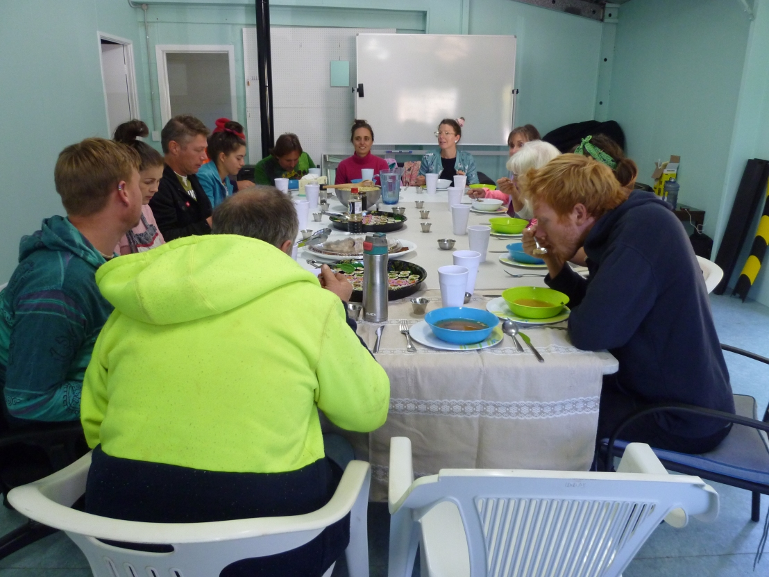 Volunteers sharing a meal at the hostel