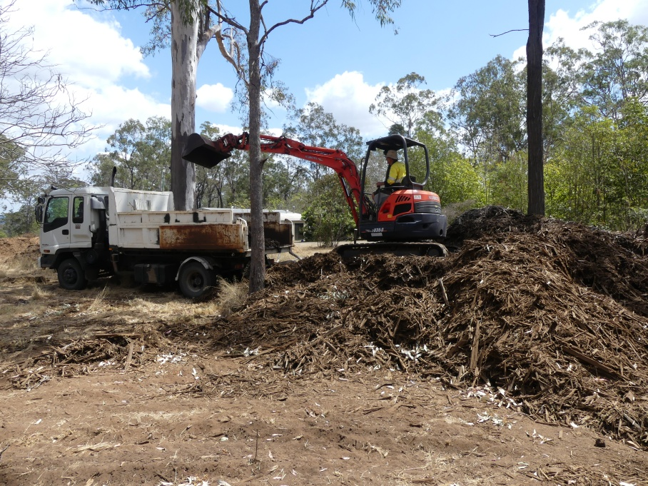 Rob loads the truck with woodchip for covering the fertility pits