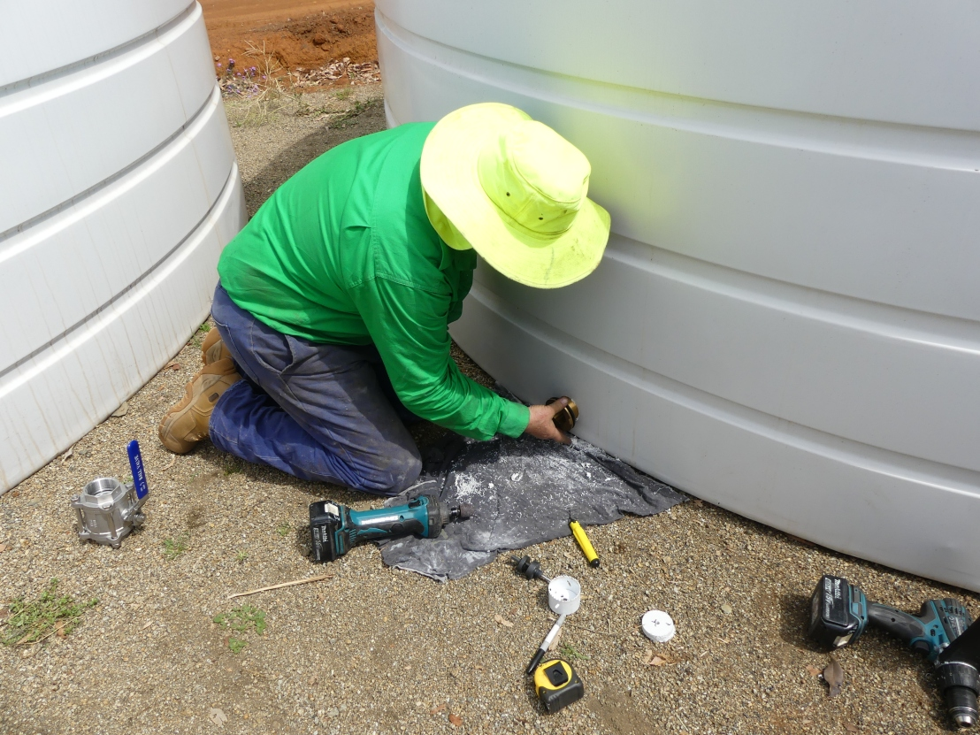 Wayne installs outlet fitting to water tank