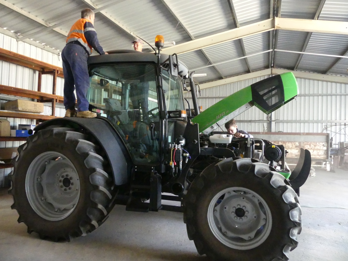 Wayne assists tractor servicing
