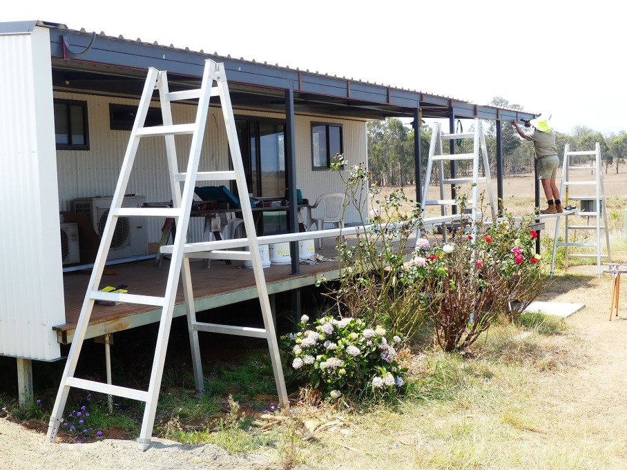Wayne prepares the house for installation of new, larger guttering