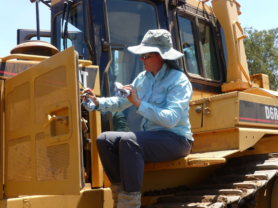 Eloisa maintains the bulldozer