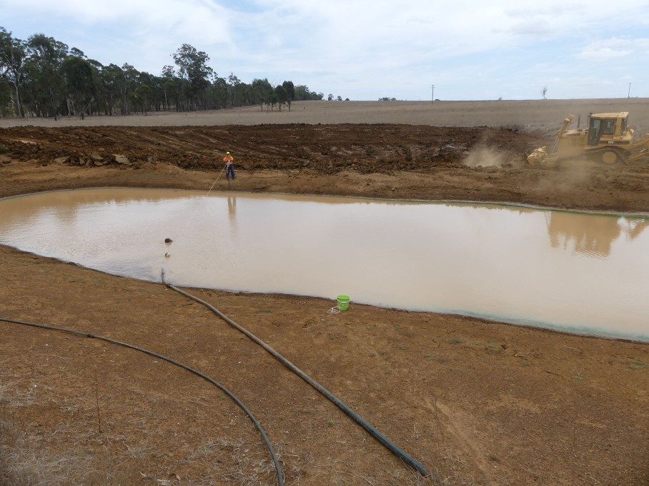 Earthworks commence while water is pumped from the dam