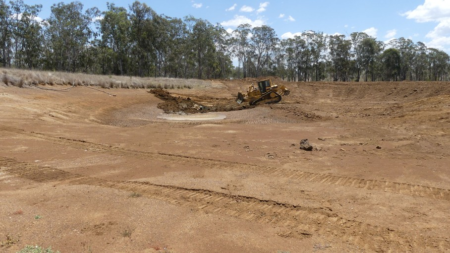 Earthworks continue in the drained dam