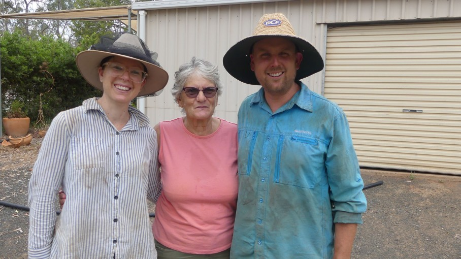 Rahni, Catherine & Tristan pose while preparing to receive a delivery of water to the property