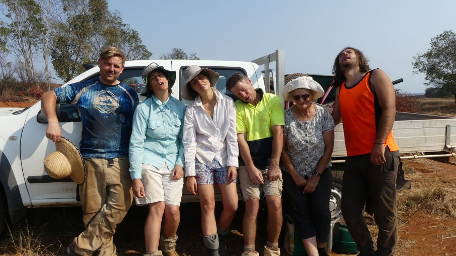 Volunteers exaggerate their exhaustion after a morning of heavy labour!