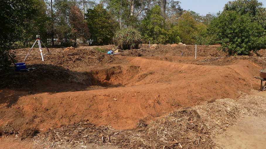Constructing fertility pits to capture and slowly release water and nutrients