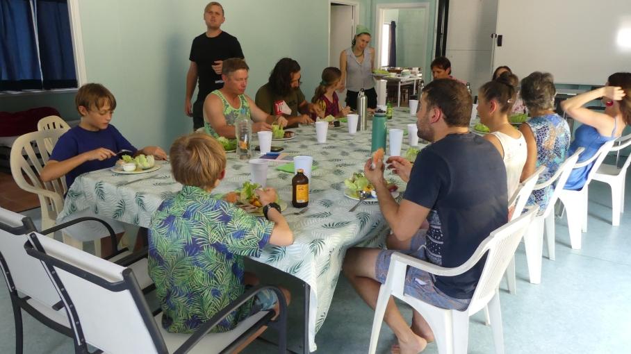 Volunteers enjoy a meal together