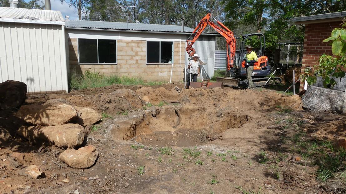 Catherine supervises excavation of rocks under pathway, February 2020.