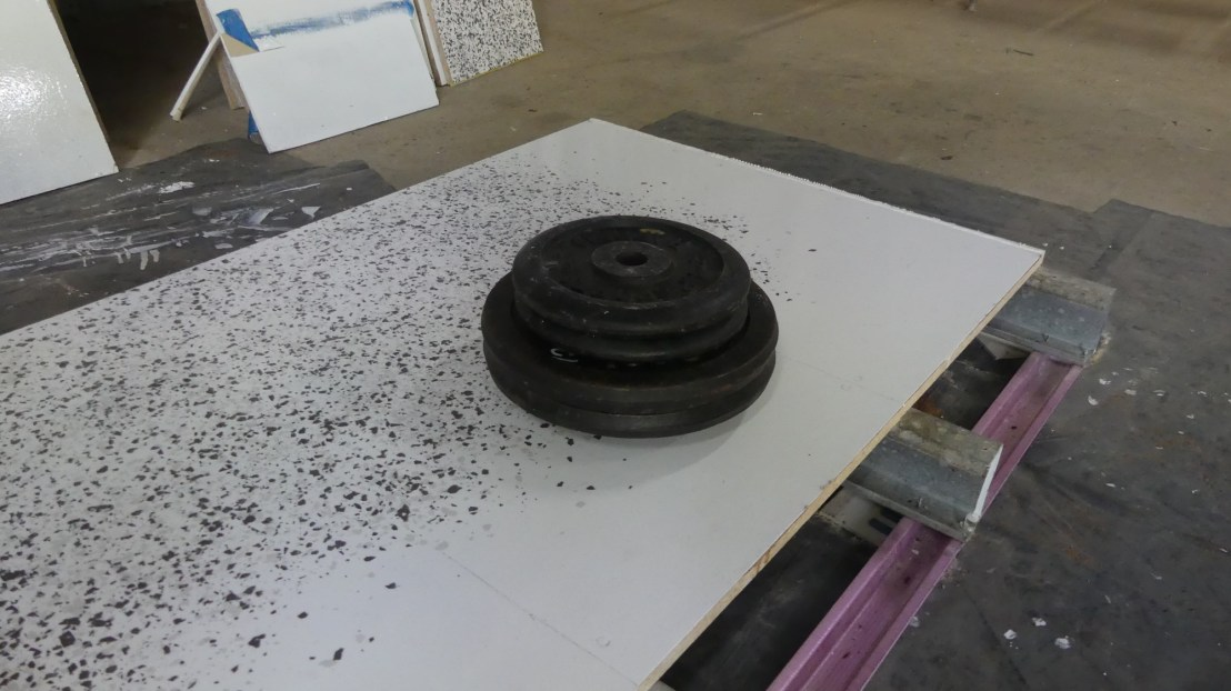 Flooring finish tests, weights dropped to see how finish performed, April 2020.