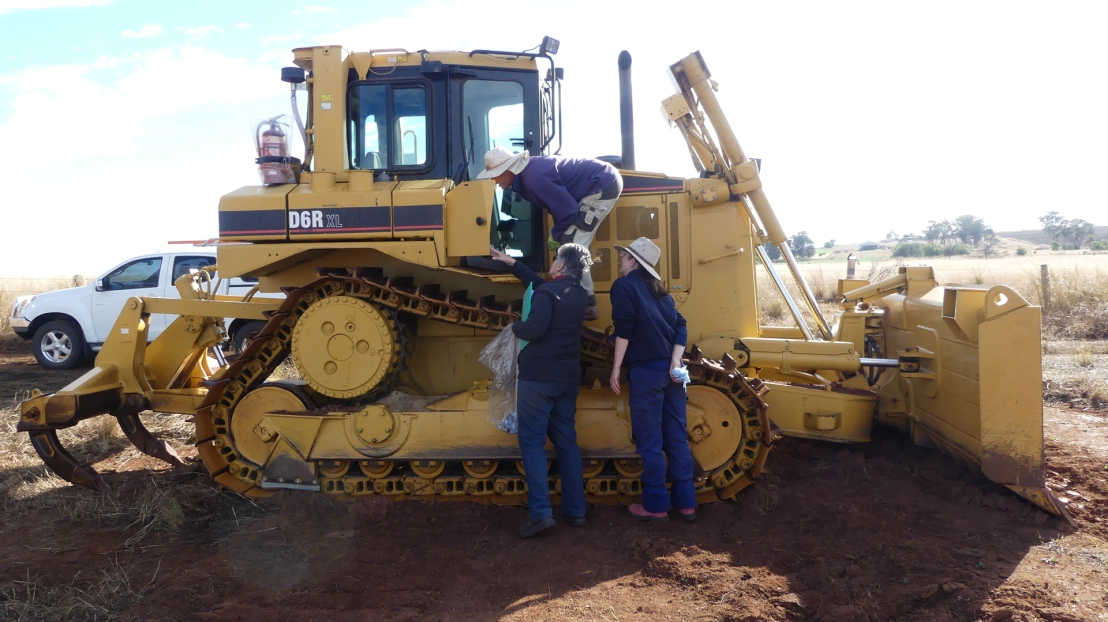 Volunteers learn heavy machinery maintenance, July 2020.