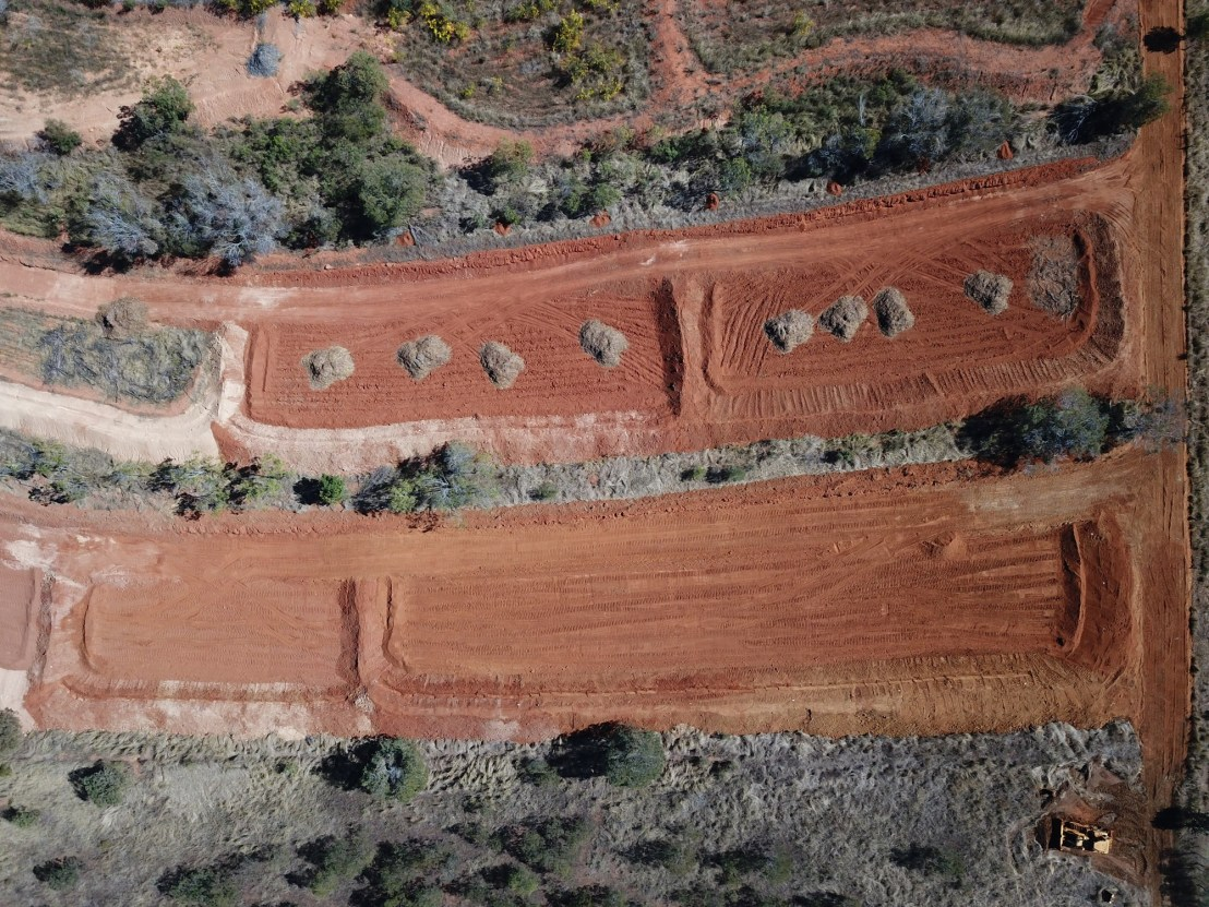 Terraces with mulch piles aerial view, August 2020.