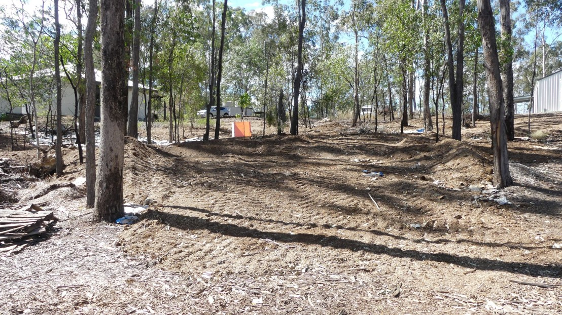 Topsoil is laid over the cardboard and seeded with Australian native plant species, August 2020.