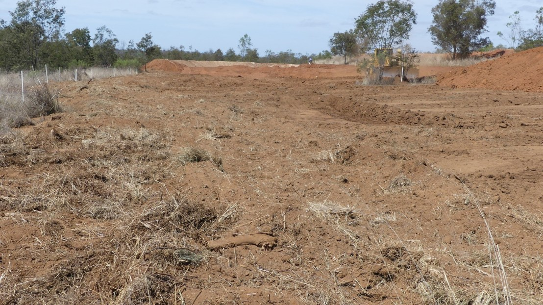 Top 100mm of soil is moved under the bank. Top soil is ready to be removed, October 2020.